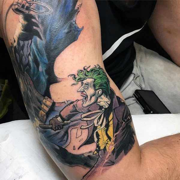 Joker Vs Batman Bicep Tattoo