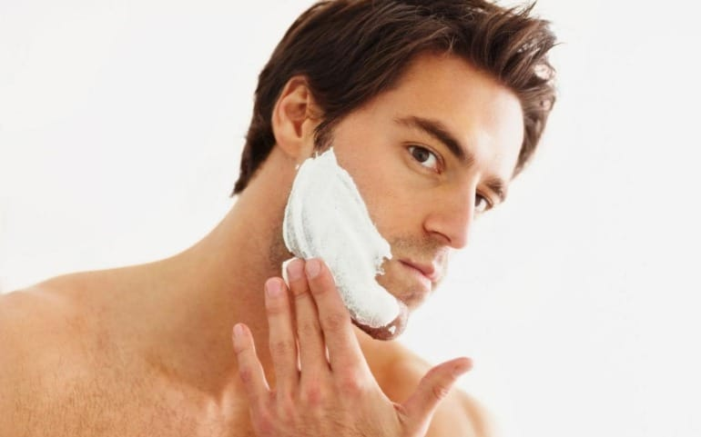 Man grooming face