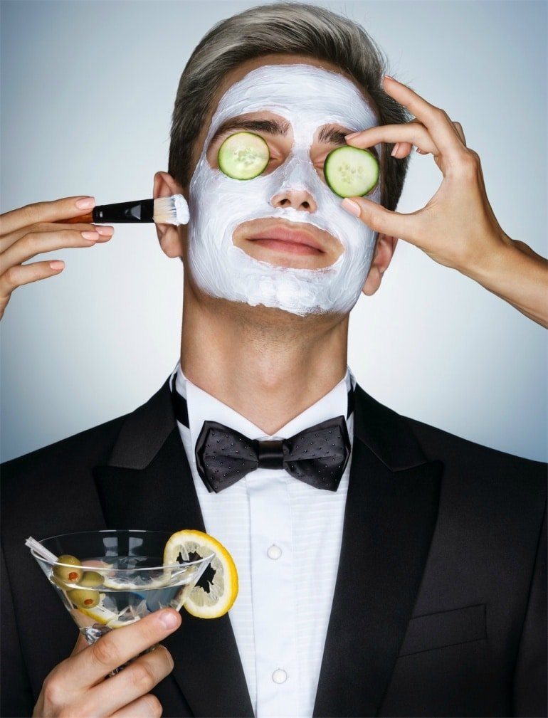 man-at-spa-day-in-suit-face-mask-cucumber-relaxation